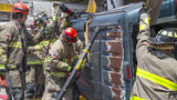Firefighters pull driver from van after rollover on West Side highway