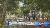 Woman escapes burning home