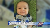 Funeral held for baby shaken and swung by father