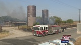 Grass fire torches hay barn, vehicles on Hwy. 151