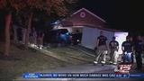Driver pulling trailer crashes into garage