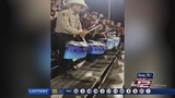 Atascosa Deputy performs with Poteet High School marching band