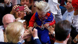 Trump autographs baby at rally