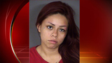Woman faces charges in armed robbery