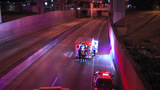 Man hospitalized after fall from embankment onto highway