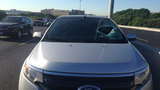 Metal rim fragment smashes through woman's windshield on Highway 281