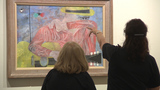 Law enforcement groups train by looking at works of art