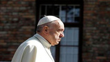 Pope visits Auschwitz, prays at saint's cell