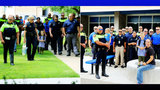 Police escort fallen officer's kids to school on their first day