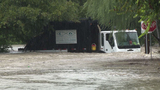 Garbage truck driver rescued from floodwaters