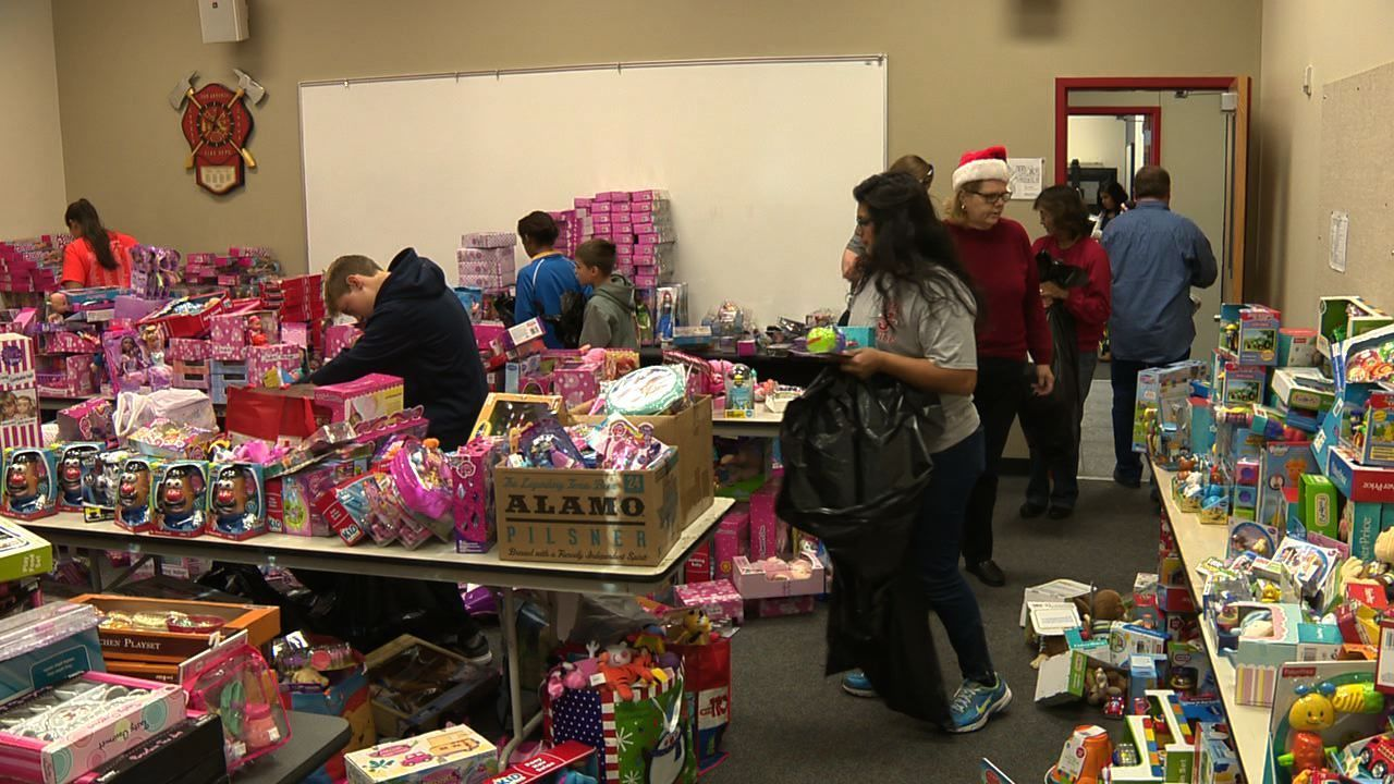 Volunteers Wrap Gifts For Thousands Of Less Fortunate Children