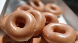 Buy a dozen Krispy Kreme doughnuts, get a dozen for $1 on Wednesday