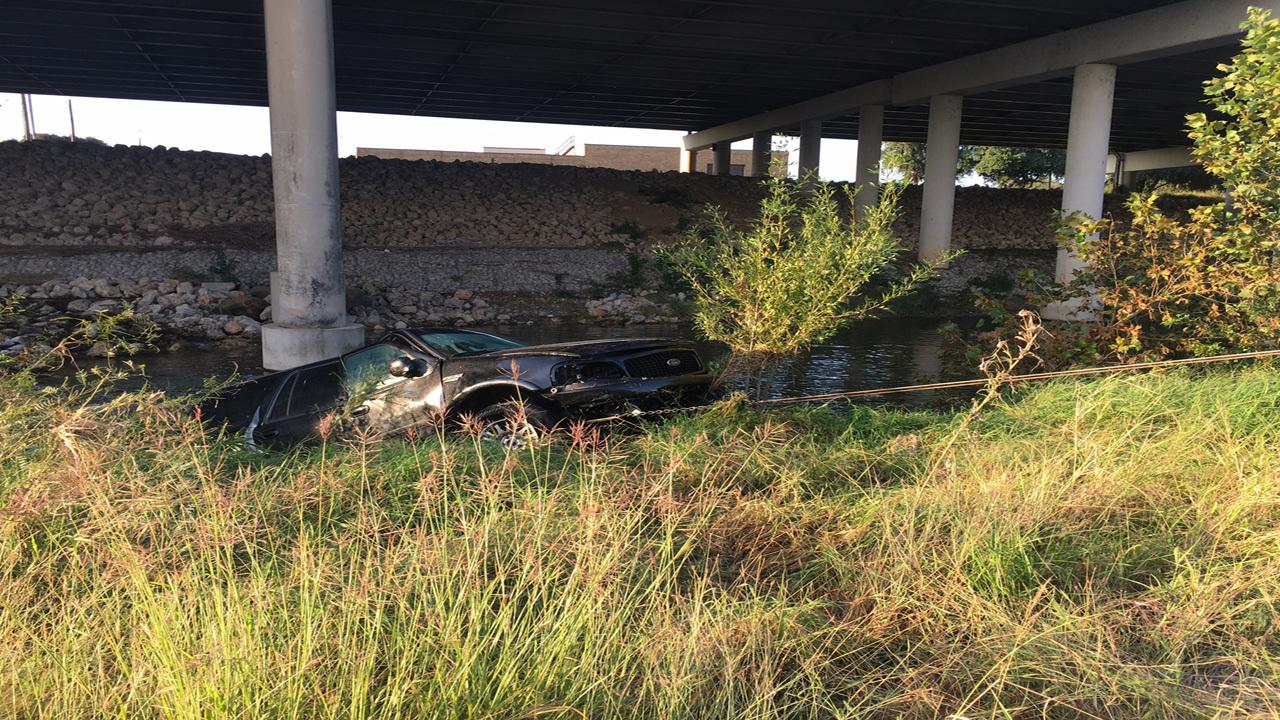 SUV drives off highway, plummets into San Antonio River below
