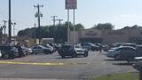 Man escapes police gunfire, runs into plate glass window
