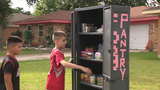 Cibolo family feeds hungry from front lawn food pantry