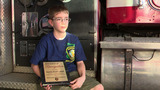 Boy honored for helping recover snakes at crash scene
