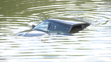 Man loses control of car, drives into San Antonio River