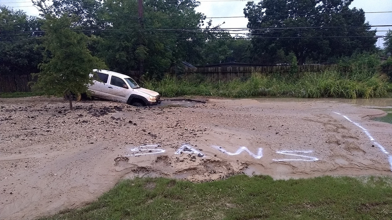 police officer drives pickup truck into sinkhole on south side