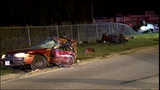 Two hospitalized after driver crashes, splits another vehicle, pole in half