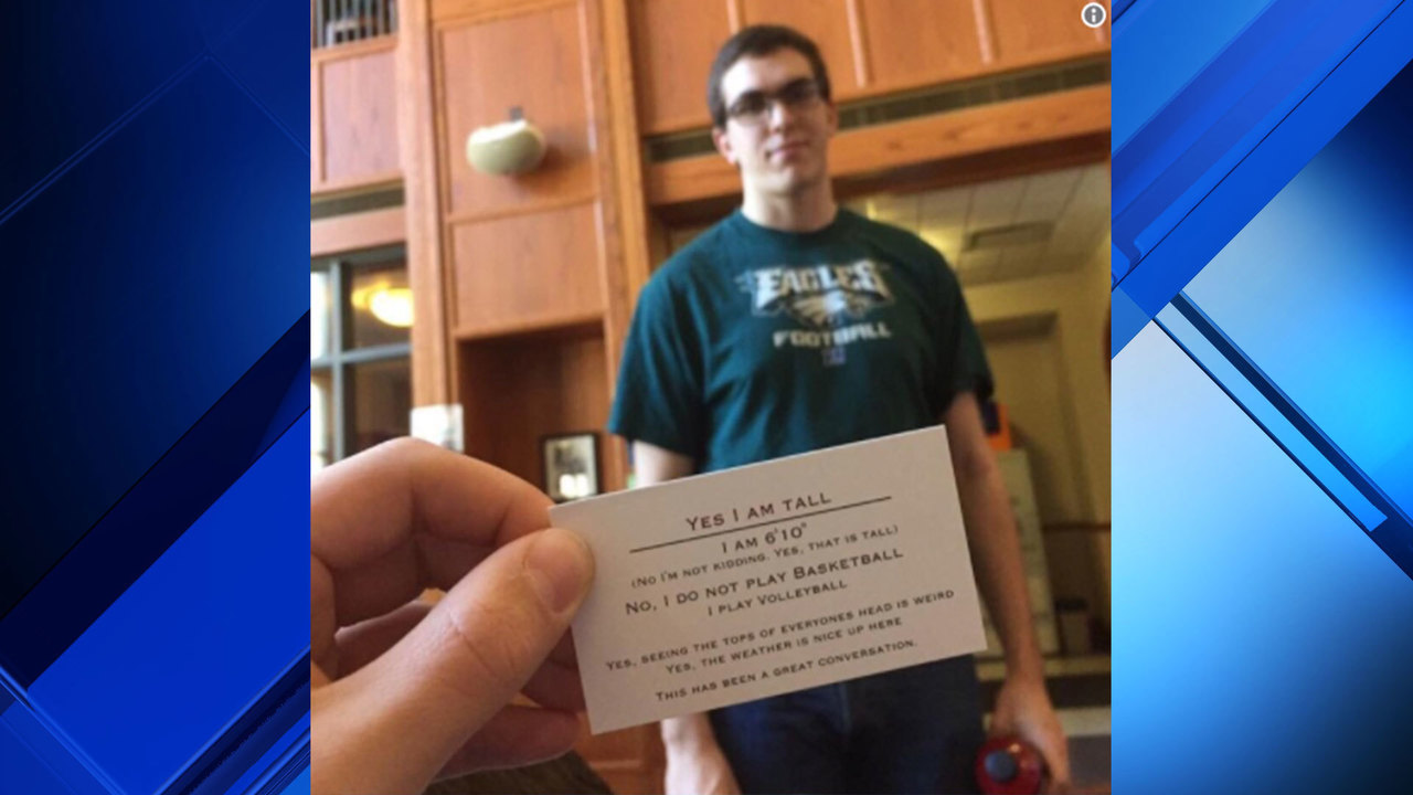 Tall man's funny business card going viral