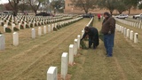 Army of volunteers brave cold, rain to decorate graves at Ft. Sam&hellip&#x3b;