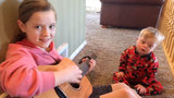 "Girl sings ""You Are My Sunshine"" to little brother with Down Syndrome"