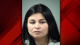 Grand jury indicts woman accused of 'poking' teen with knife, hitting her