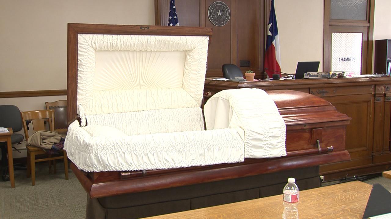 julie mott trial: casket brought into courtroom for