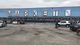 21-year-old man charged in flea market murder