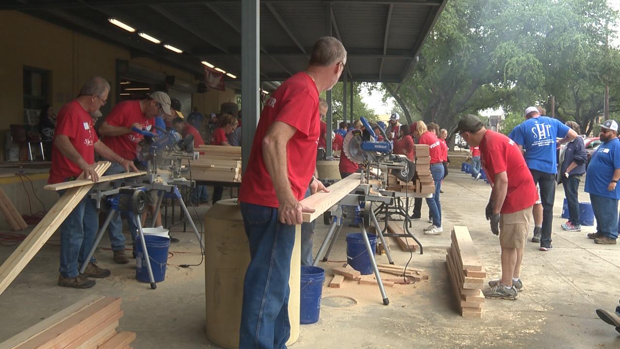 Nonprofit, volunteers build bunk beds for children in need