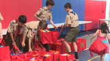 Boy Scout helps organize summer breakfast meals for 100 families
