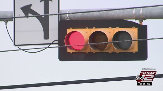 'It's now law': Gov. Greg Abbott signs bill banning red light cameras