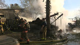 Flames level trailer home, carport in early-morning blaze&#x3b; 1 other home damaged