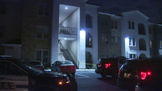 Woman pushed off second-floor balcony during argument, police say