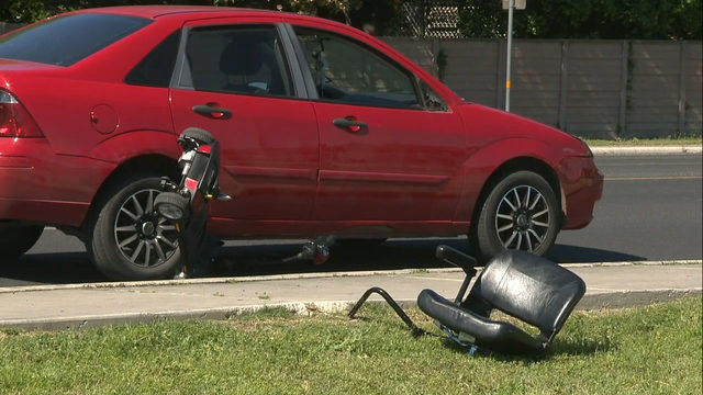 Woman on motorized wheelchair sideswiped by car, police say