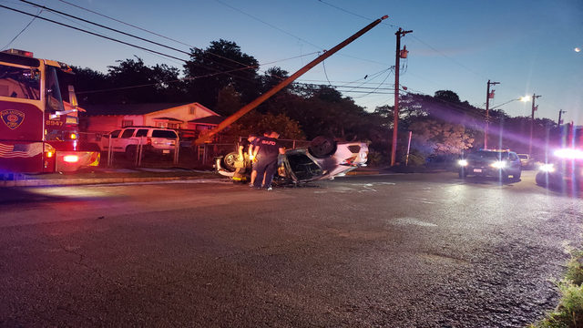 Driver of stolen car flees after rollover crash into telephone pole, police say