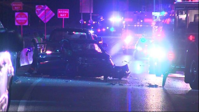 One woman dead, 4 in hospital in officer-involved crash