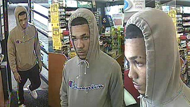 Hooded man displays handgun, demands cash from register