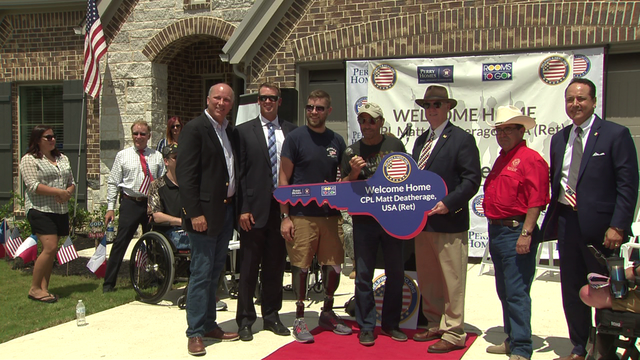Wounded war hero gets hero's welcome in his new home
