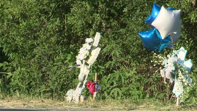 Makeshift memorial appears at site of crash that claimed life of 3-year-old