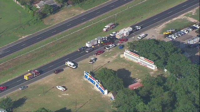Hazmat crash, spill closes highway; 5 taken to hospitals