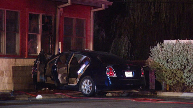 Car bursts into flames after crashing into Bill Miller Bar-B-Q