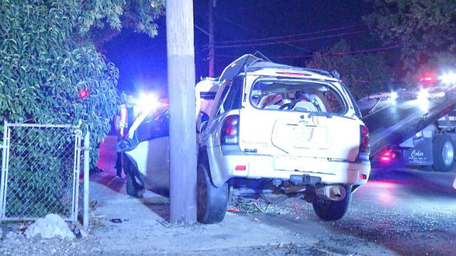 Woman extracted from vehicle after crash with utility pole