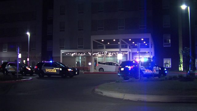 Man shoots woman outside northside hotel, police say