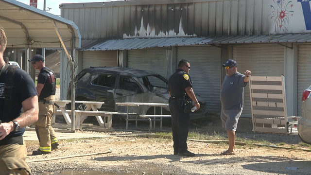 Car catches fire near firework stand, creating fiery display