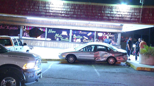 SAPD: Driver crashes vehicle into parked car, restaurant
