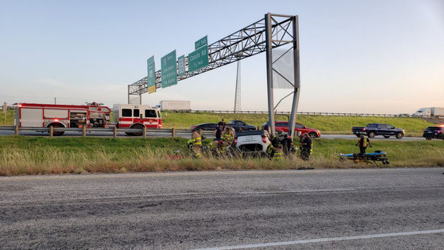 Woman rescued from SUV after rollover crash on I-35