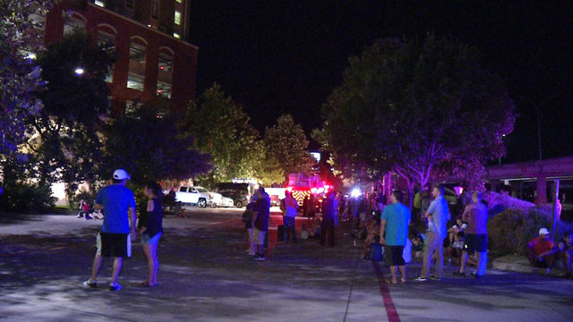Car fire in parking garage forces evacuation of hotel