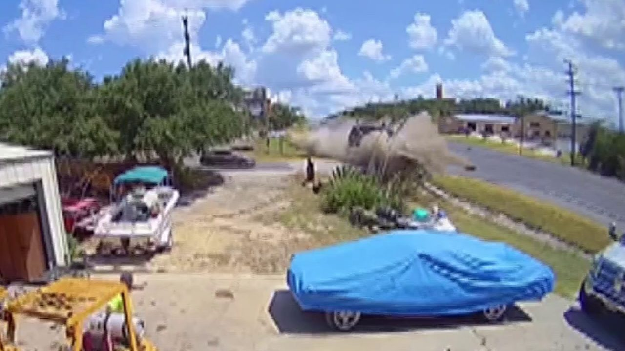 Insane video shows truck hauling trailer go airborne, crash
