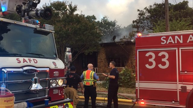 Dozens of firefighters battle blaze at a West Side home